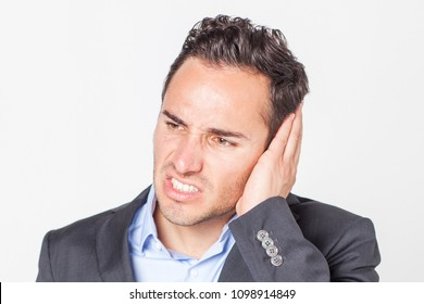 Businessman suffering from ear pain