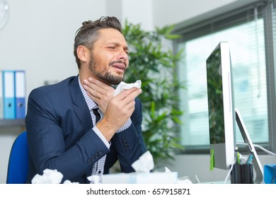 businessman suffering from sore throat