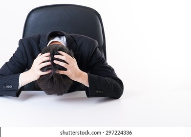 Businessman suffering to suffer a head