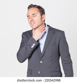Businessman suffering from throat problems
