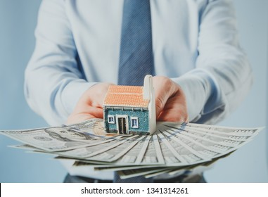 Businessman suggesting you money for house purchase