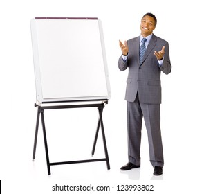 Businessman in suit with blank presentation easel gesturing with hands