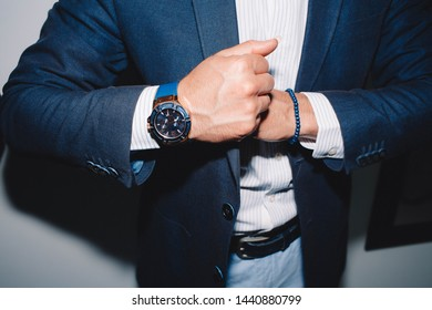 Businessman in suit close-up.Fashion portrait of young businessman handsome model man in casual cloth suit with accessories on hands