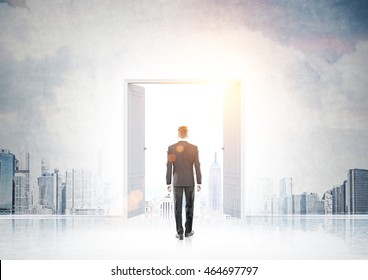 Businessman in suit entering doorway in wall with New York panorama pictured on it. Concept of founding new business in big city.