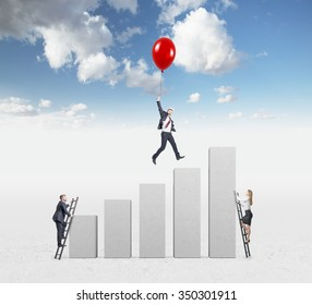 businessman in a suit flying happily holding a balloon over carrer ladder, man and woman climbing ladders, blue sky at the background, concept of success and career growth