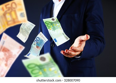 Businessman in suit with flying money