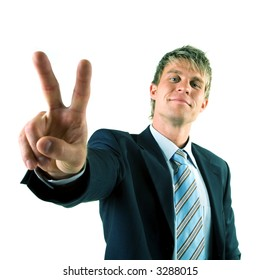 A businessman in a suit giving the victory sign (the hand appearing big)