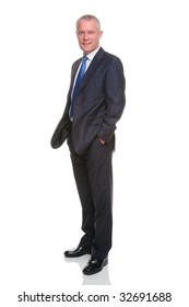 Businessman in suit with his hands in his pockets, isolated on a white background.