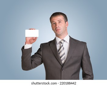 Businessman in suit hold empty white card