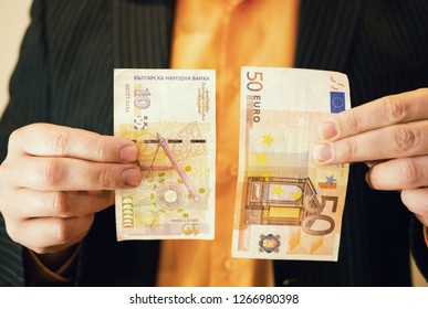businessman in suit holding Bulgarian levs banknote money in one hand and 50 fifty Euros in other hand. closeup shot depict Bulgaria schengen zone approval