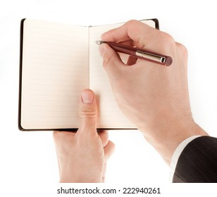Businessman in suit holding an empty notepad (notebook) isolated on white