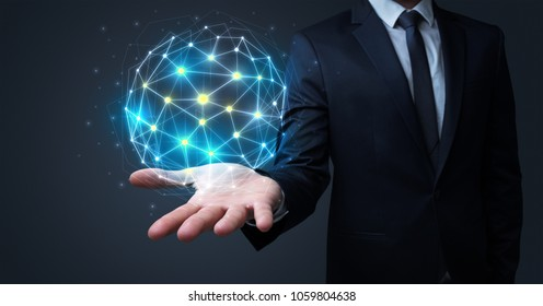 Businessman in suit holding global connection symbol on his hand