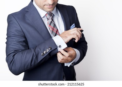 Businessman in suit holding a phone