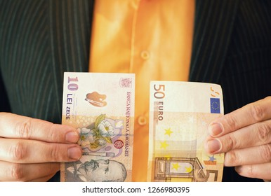 businessman in suit holding Romanian lei banknote money in one hand and 50 fifty Euros in other hand. closeup shot depict Romania schengen zone approval