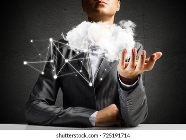 Businessman in suit keeping cloud with network connections in hand with gray wall on background. 3D rendering.