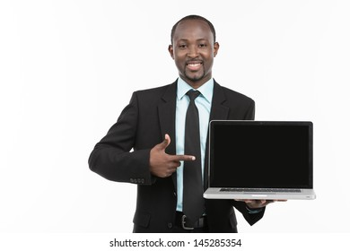 Businessman in suit with laptop on white background