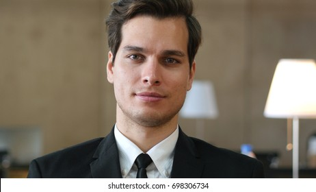 Businessman in Suit Looking at Camera, Positive Emotions on Face