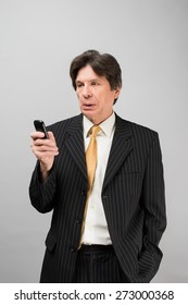 businessman in a suit with a mobile phone
