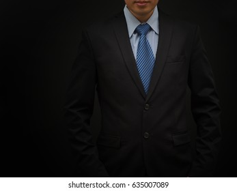 Businessman in suit on back background