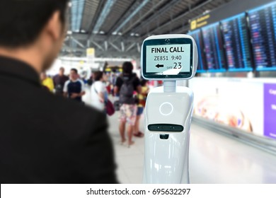Businessman suit passenger use self driving chcek-in robots assistant for ticket and accompany them to their gate at international airport.