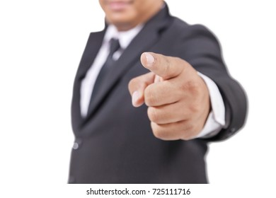 businessman in a suit pointing with his finger