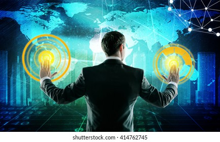 Businessman in suit push digital screen with icons, world map and wire-frame buildings. E-business concept