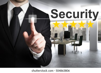 businessman in suit pushing button security office