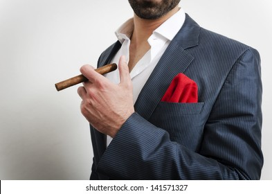 Businessman in a suit with red handkerchief smoking cigar