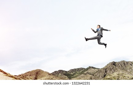 Businessman in suit running in the air as symbol of active life position. Skyscape and nature view on background. 3D rendering.
