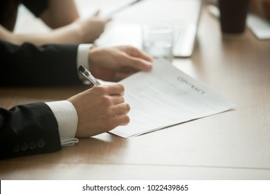 Businessman in suit signing business contract making deal, investor or executive putting signature on commercial paper, filling legal document in lawyers office, taking loan insurance, close up view