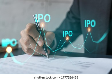 Businessman in suit signs paper. Double exposure with IPO icon hologram. Man signing contract agreement. Primary stock issue market analysis and investment concept.