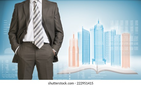 Businessman in suit standing and holds hands in pockets. Glowing wire-frame buildings on open book as backdrop