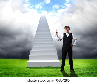 Businessman in suit standing near stairs going up