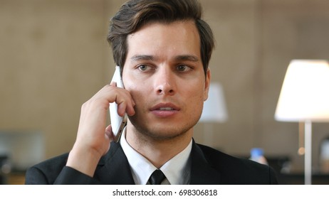 Businessman in Suit Talking on Phone, Close Up