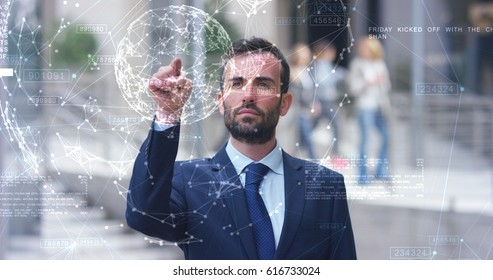 A businessman in a suit uses holography and augmented reality to see in 3D graphics financial economics. Concept: immersive technology, business, economy, futuristic
