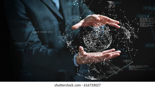 A businessman in a suit uses holography and augmented reality to see in 3D graphics financial economics on a black background. Concept: immersive technology, business, economy, futuristic