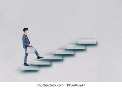 Businessman in suit walking up stair to achievement, man is leader climbing with aspiration for goal, inspiration and development for inspiration while progress go to winner, business concept.