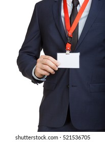 Businessman in suit wearing a blank ID tag or name card on a lanyard at an exhibition or conference