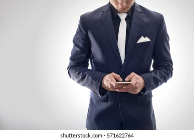 Businessman in suit, working on phone