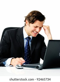 Businessman in suit works too hard and suffers from a painful migraine