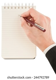 Businessman in suit writing on empty notepad (notebook) isolated on white