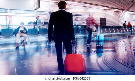 Businessman and suitcase in the airport departure lounge, with a travel concept,summer vacation concept, traveler suitcases in airport terminal.