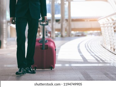 Businessman and suitcase in the airport departure lounge with a travel concept,summer vacation concept, traveler suitcases in airport terminal.