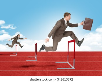 Businessman with suitcase  hopping over treadmill barrier