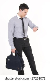 Businessman with suitcase, watching what the time is it