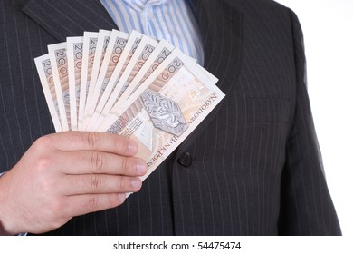 Businessman in suite holding polish money