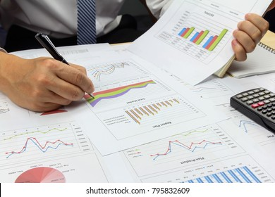 Businessman Summary report plan and financial analyzing product market plan, and Review accounting data and calculate order income.