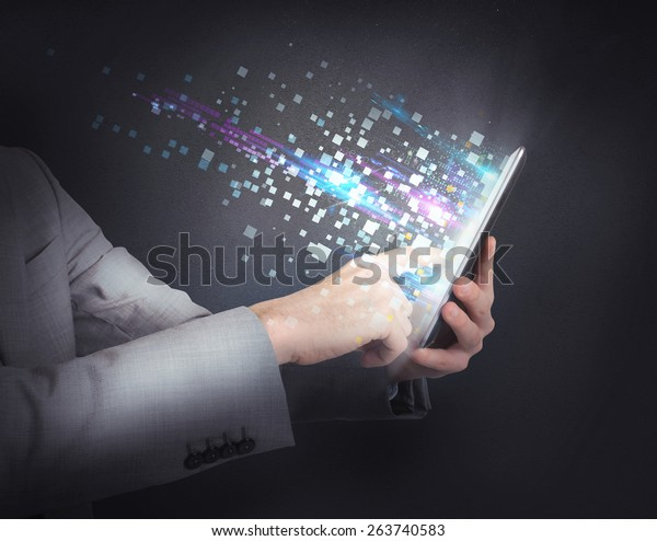 Businessman surfing the internet with the tablet