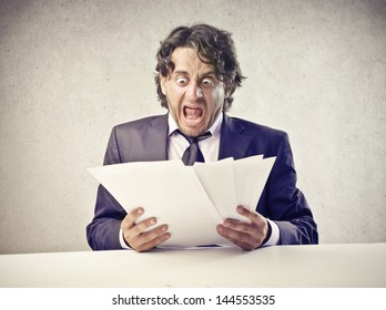 businessman is surprised by reading the documents