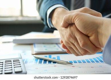 Businessman in sut hand shake in ofiice closeup. Introduce manager job man risk chart paper how deal teamwork employment complite finish paperwork concept